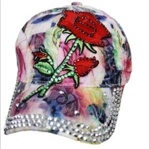 Embroidered rose on a bling water color cap.